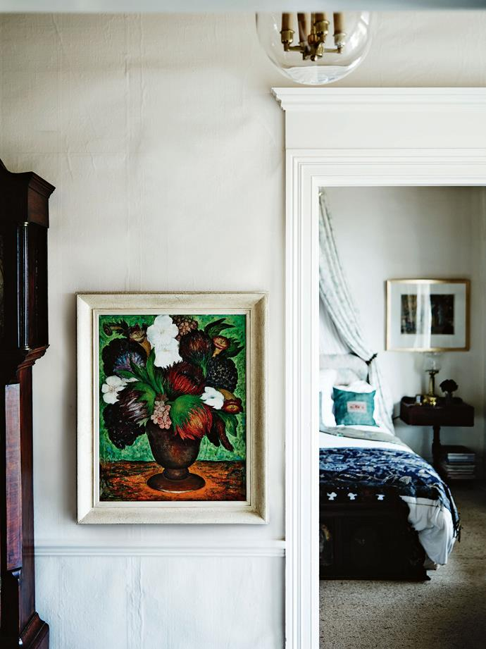 Painted in 1967, the floral still life in the hall outside the guest bedroom is by Melbourne's Florence Shirlow.