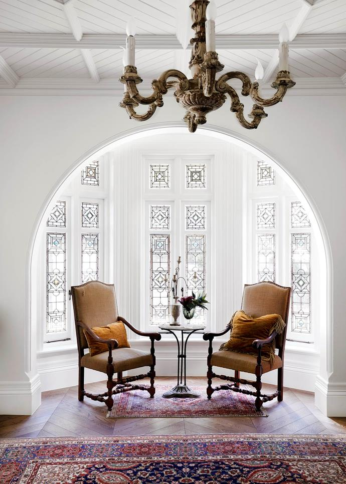 "Tanya Hancock Architects were hired to turn this [Gothic Revival house](https://www.homestolove.com.au/gothic-revival-home-19307|target=""_blank"") into a light-filled family home. Antique timber chandelier from Elements I Love. Louis XVI chairs from The Country Trader. Antique bistro table from Le Marché Antiques. From *Belle* November 2018."