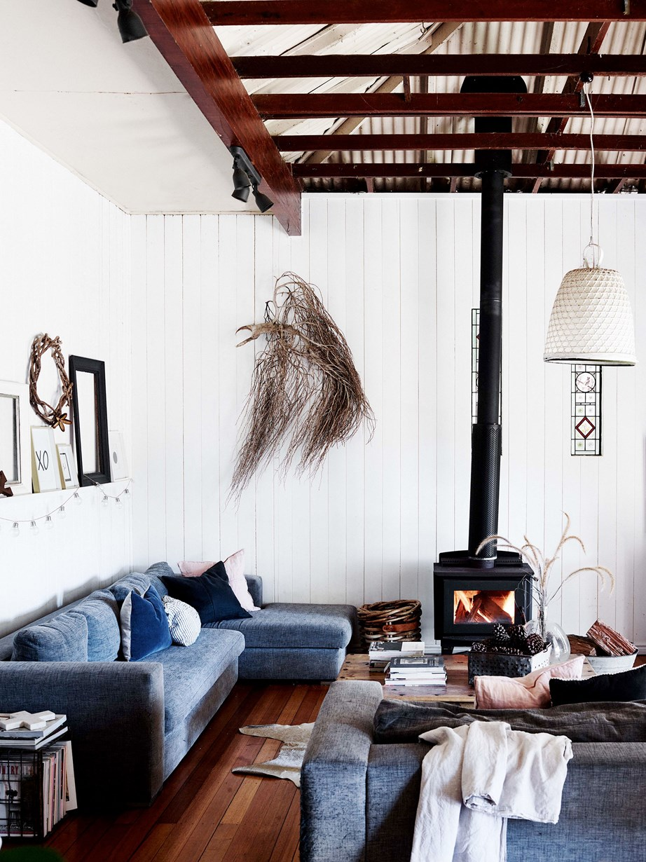 "The lounge room in this [renovated river cottage](https://www.homestolove.com.au/river-cottage-australia-20311|target=""_blank"") is a cosy space with grey Domayne sofas, rustic decor and a central fireplace."