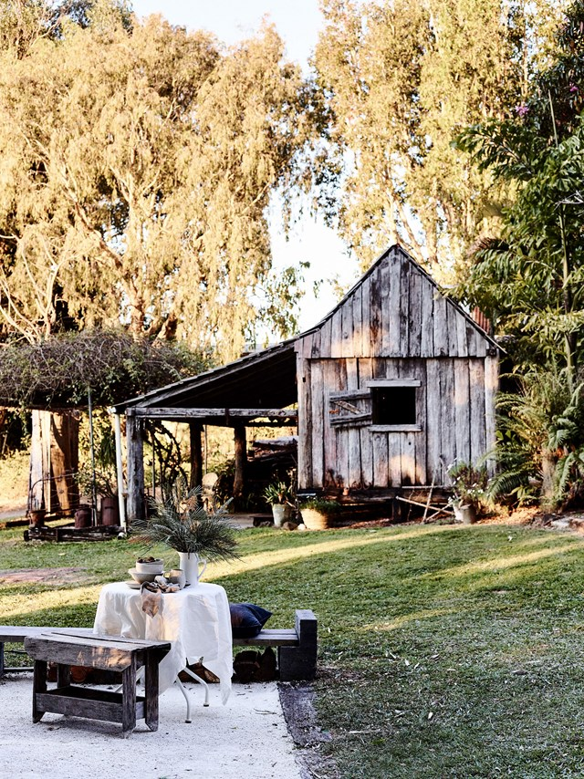 "Along with a beautifully renovated [river cottage, this property in Bilambil, NSW](https://www.homestolove.com.au/river-cottage-australia-20311|target=""_blank""), also features a slab hut with a fireplace that's around 150 years old. The barn is a much-loved family retreat in winter but the Britts like eating outside in the warmer months."