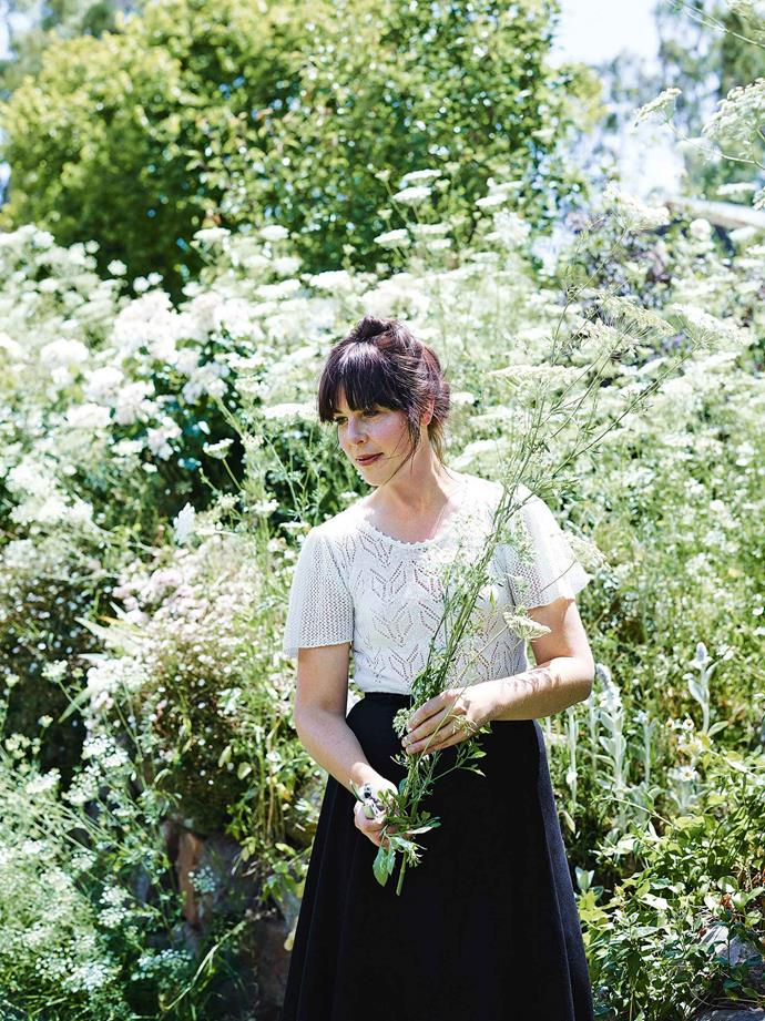 Morgan gathers Queen Anne's lace in the garden of her Adelaide Hills cottage.