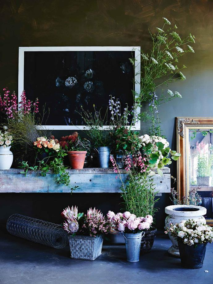 "A giclee photographic print from a recent exhibition hangs above the studio's flower bench. Morgan loves creating arrangements with the [cottage garden](https://www.homestolove.com.au/garden-design-styles-19942|target=""_blank"") flowers she adores, the ""English floral aesthetic"". ""I like to use rambling roses, foliage and local irises, plus a lot of flowers from commercial growers that I'll use to evoke their aesthetic,"" she says. ""Then I'll add some of my own garden flowers to bring the arrangement to life."""