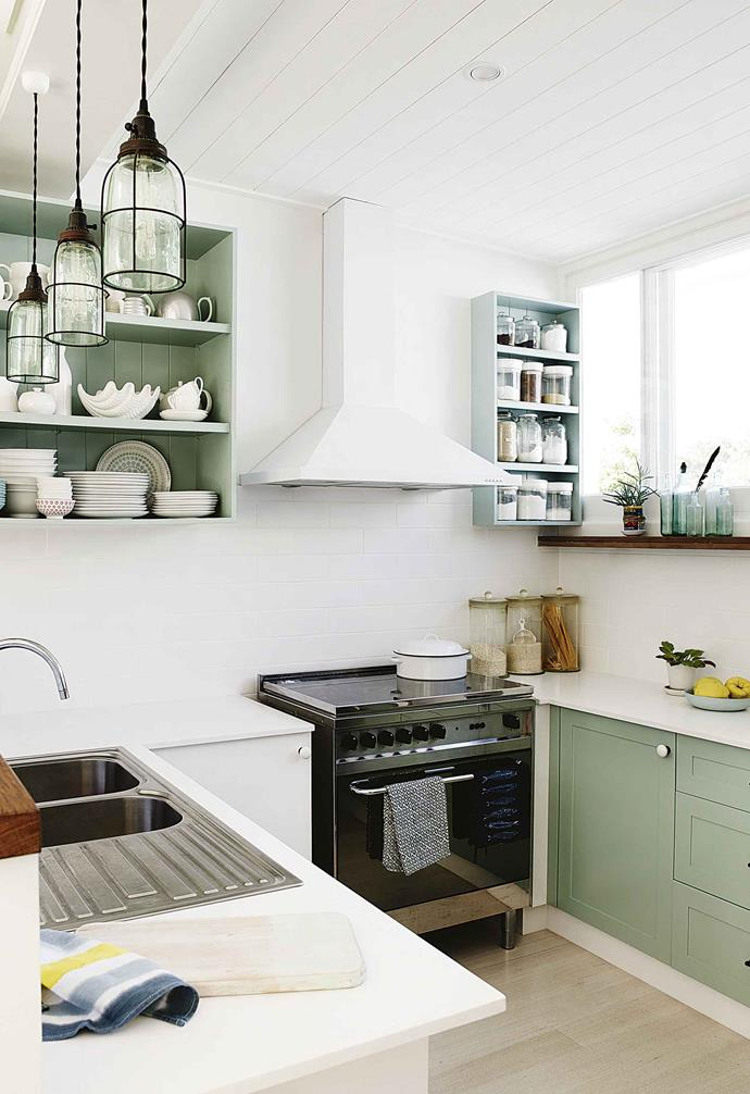 "The kitchen in this [Art Deco meets coastal home](https://www.homestolove.com.au/coastal-art-deco-house-18746|target=""_blank"") proves that subtle splashes of colour is a great way to add style and depth to a small cooking zone. Having the rangehood match the wall colour is a clever way to make bulky items blend into the background."