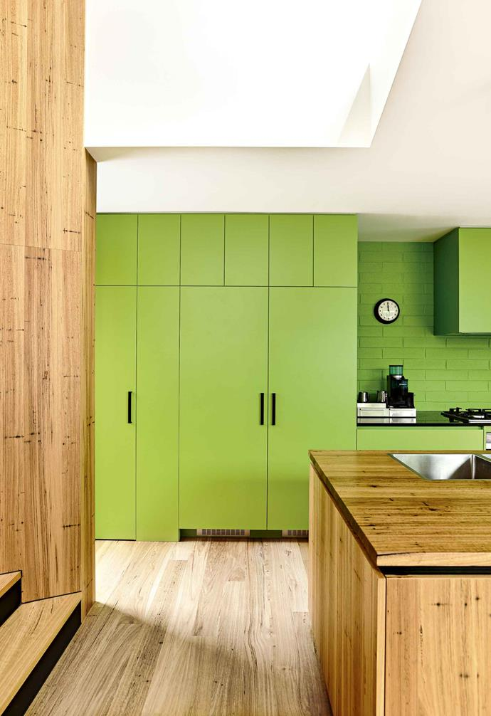 "A light coloured timber bench and floorboards help to balance the intensity of the lime green cupboards and painted brick wall in this [family friendly bungalow](https://www.homestolove.com.au/8-design-lessons-from-a-family-friendly-bungalow-18078|target=""_blank""). Owners Ri and Nick were determined to have the laminate green kitchen cabinets in the heart of their home."