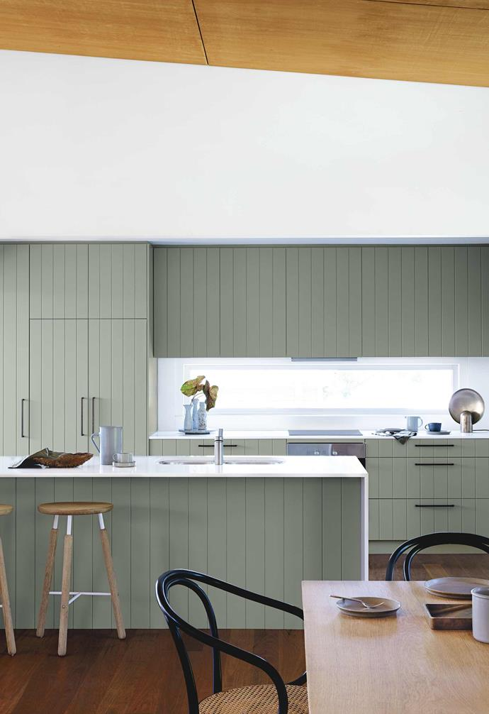"Originally designed by David Boyle Architect, this [Macmasters beach house](https://www.homestolove.com.au/macmasters-beach-house-18226|target=""_blank"") takes its cues from its natural surrounds with the timber panelled kitchen cabinetry painted a dusty sage. White slimline bench tops provide contrast."