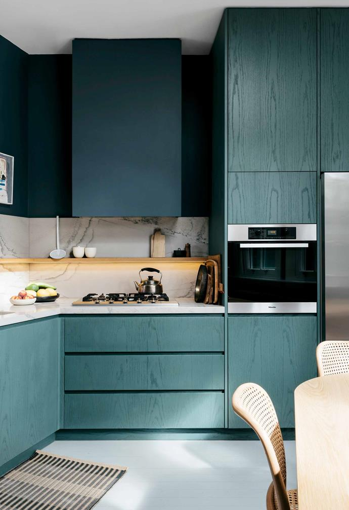 "Director Jonathan Richards of Richards Stanisich has created a dramatic look in his [designer kitchen](https://www.homestolove.com.au/designer-kitchens-19818|target=""_blank"") with rich green cabinetry paired with a marble benchtop and splashback. Stainless steel appliances create a striking contrast."