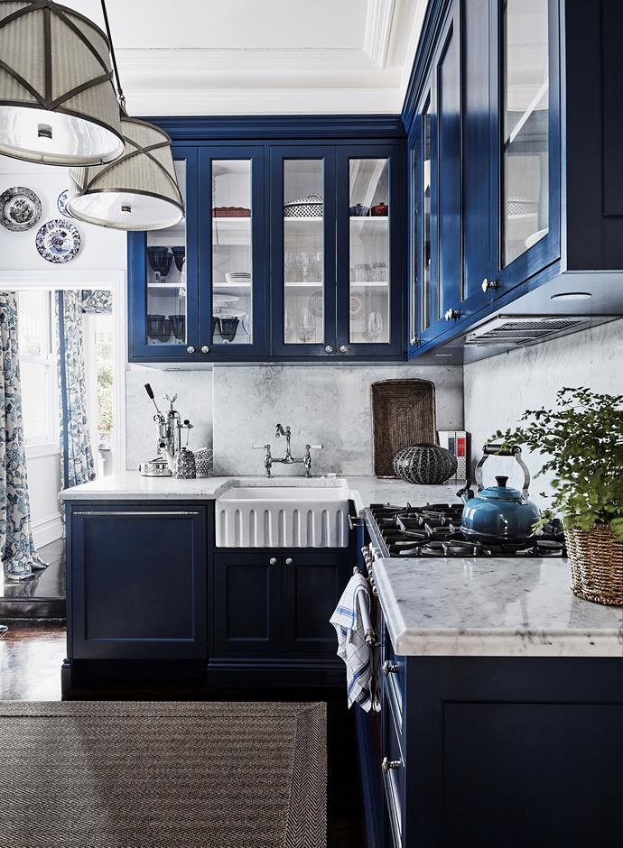 Carrara marble looks striking but needs careful maintenance; Lauren cleans it with a non-toxic product, Murchison-Hume Counter Intelligence. Behind the sink is the original chimney. Cabinets painted in Dulux Sharp Blue. Oven, Ilve.