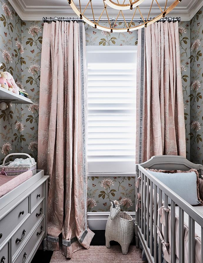 Colefax and Fowler 'Messina' wallpaper in Aqua is the prettiest of backdrops for baby Aerin's room. Curtains in Lavinia linen-viscose fabric, Domus Textiles. Blythe change table/dresser and convertible cot, Pottery Barn Kids.