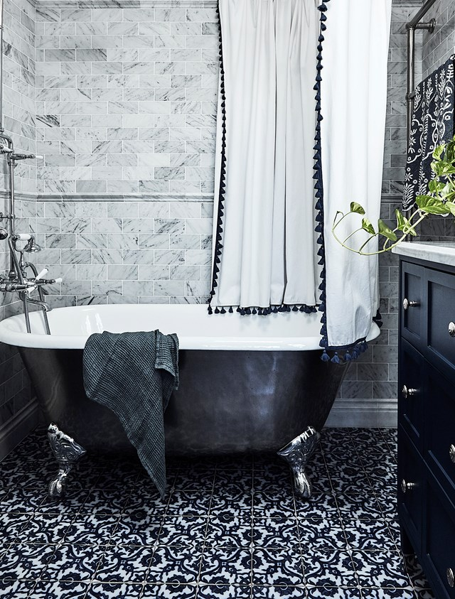 "While it's common to stick to one feature tile in a bathroom, Damascus floor tiles (imported from the US) paired with Carrara marble tiles, from Surface Gallery, have an enchanting effect in the bathroom of this [1880s Sydney terrace](https://www.homestolove.com.au/1880s-sydney-terrace-home-with-charming-interiors-20319|target=""_blank"")."