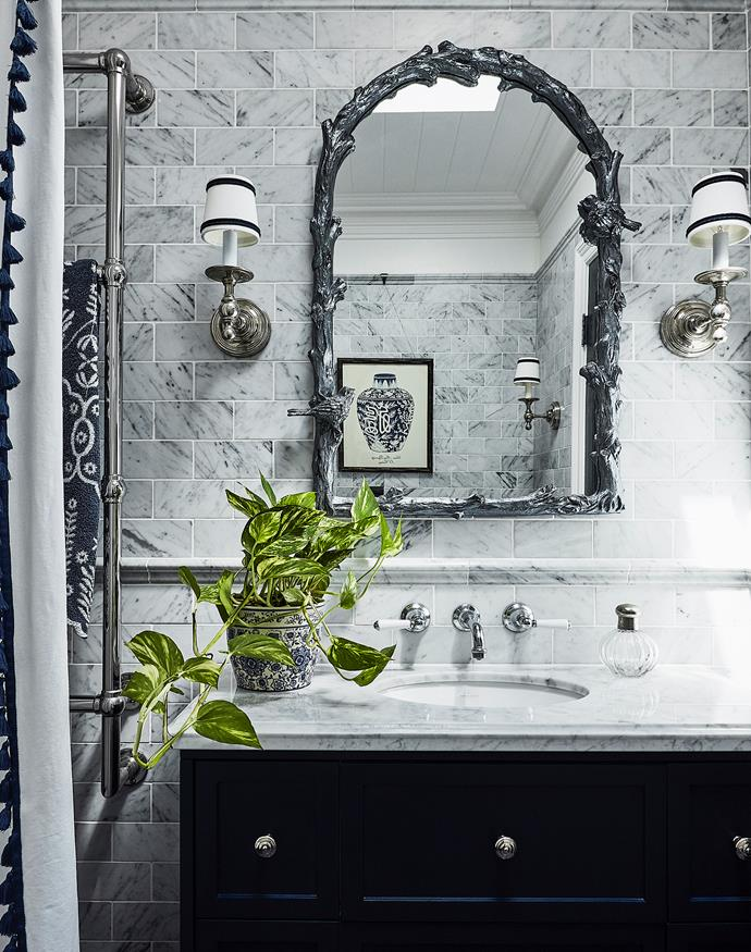 The Uttermost 'Paza' mirror was originally copper; Lauren refreshed it with Porter's Paints Duchess Satin in French Silver. Olde English tapware, Astra Walker. Rosenheim bath, Prodigg.