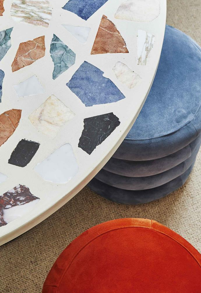 A terrazzo dining table and suede ottomans from The Playhouse, Tali's shoppable office.