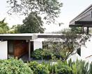 A Japanese-style garden with a mid-century modern touch