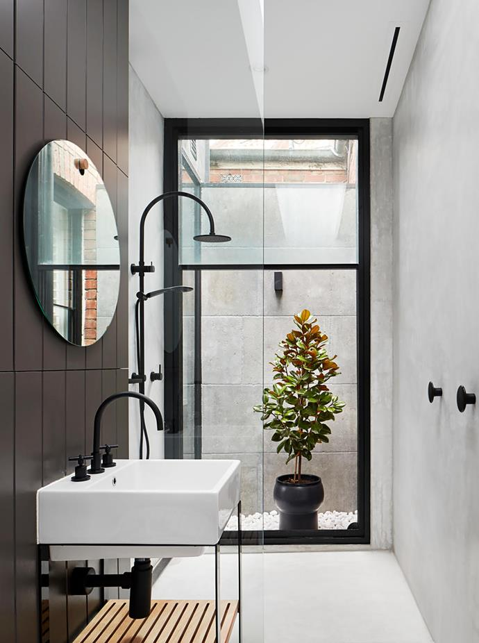 A tiny outdoor space expands the reach. Walls and floors in X-Bond polished bond by Alternative Surfaces. Designer buys: Acqua 50 basin, $699, and stand, $1099, Studio Bagno.