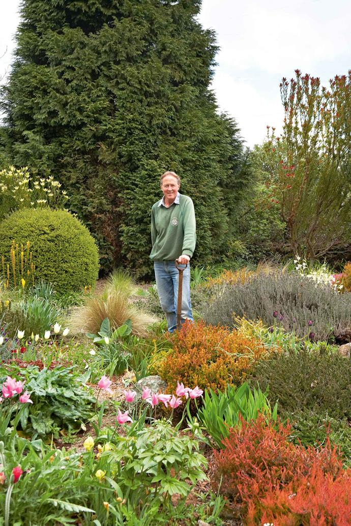 Don surrounded by heather at the top of the garden. As well as maintaining Winterwood, breeding new species, and selling bulbs and cut flowers, Don does gardening work for clients in the district.