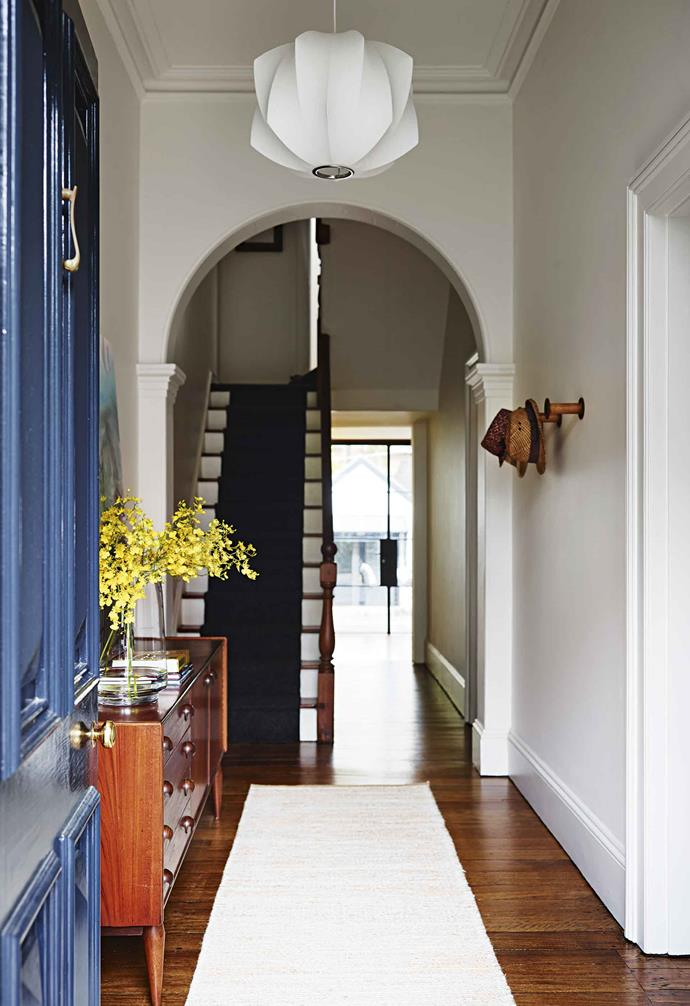 "The couple had been longing for a larger dining/kitchen area. ""The rooms were all small and poky – they didn't flow easily into each other,"" says Matthew of the old layout. ""With the kids being school age, we wanted a flexible space where we could cook, do homework and hang out as a family.""<br><br>**Entryway** A bold [blue front door](https://www.homestolove.com.au/front-door-colour-ideas-19810