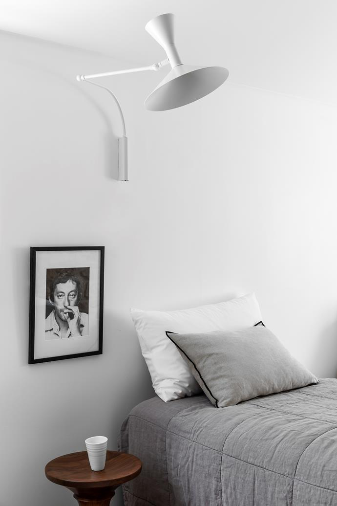 The upstairs bedrooms have all been given the same treatment, with comfort and relaxation top priorities. Here, a Le Corbusier wall light illuminates the bed and Eames stool below. Cushions from Montmartre and a grey Ondene quilt ramp up the comfort stakes.