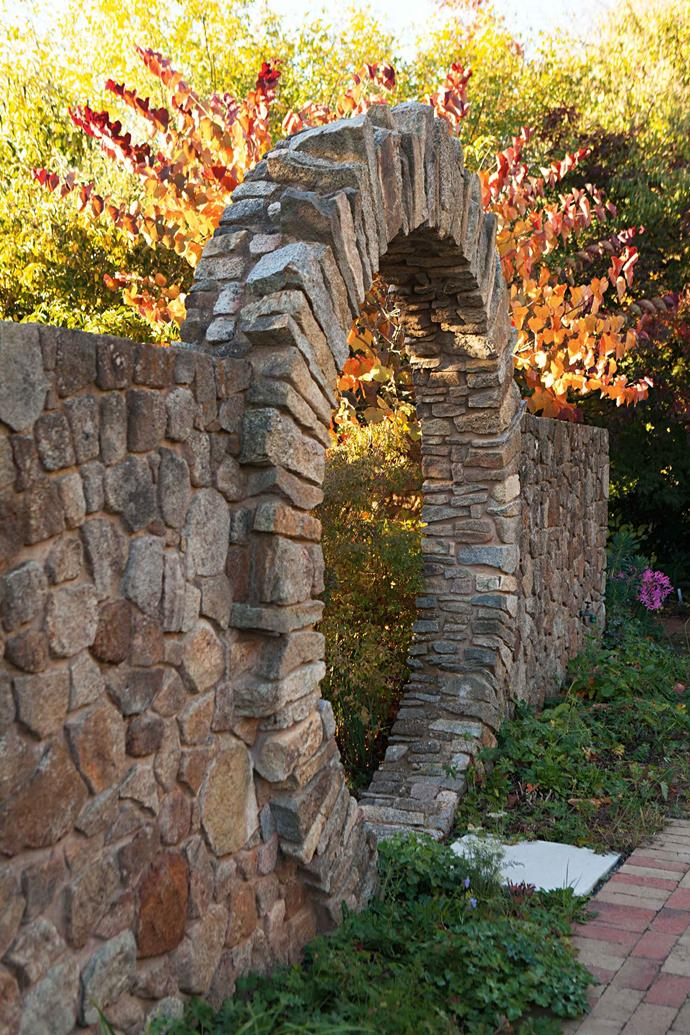 """A moon gate of local granite (another inspiration from a book) leads to a black and white garden. A palette of dark foliage and white flowers is strictly adhered to. A dark purple Cercis canadensis 'Forest Pansy' thrives next to a white-flowering abutilon; dark [mondo grass](https://www.homestolove.com.au/ornamental-grasses-australia-19276