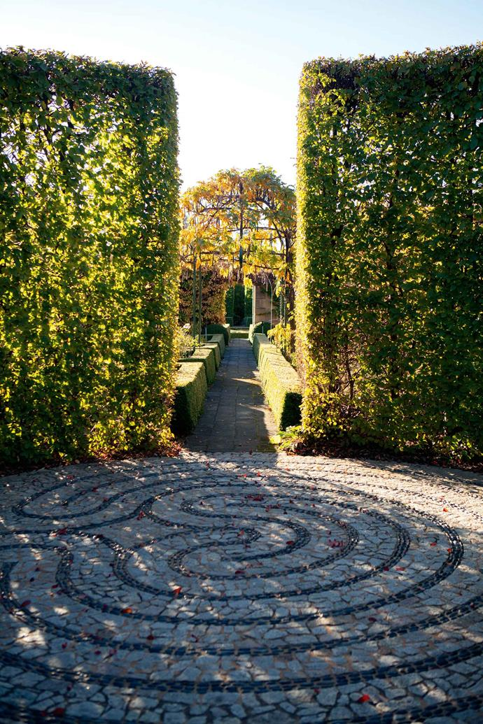 """A classical labyrinth in stone and pebbles, inspired by a Spanish example Craig's parents, John and Margaret, live on the property, and Craig says they are a great support. """"Mum helps with the garden, and Dad helps with grass cutting and the building projects."""""""