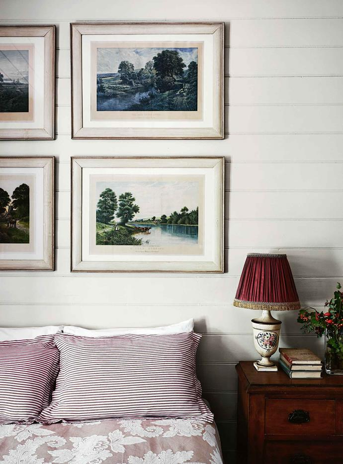 "Prints of pastoral paintings by British artist Edwin Edwards hang in the guest bedroom. Nearly a decade on, Nigel and Andrew reflect on the journey to create the country home and garden of their dreams — and on the man who had such an influence on its course. ""Stuart was a very dear friend who inspired us in this home, and everything we've achieved is because of him,"" Andrew says. ""We never imagined how doing this house and garden would take on a life of its own."""