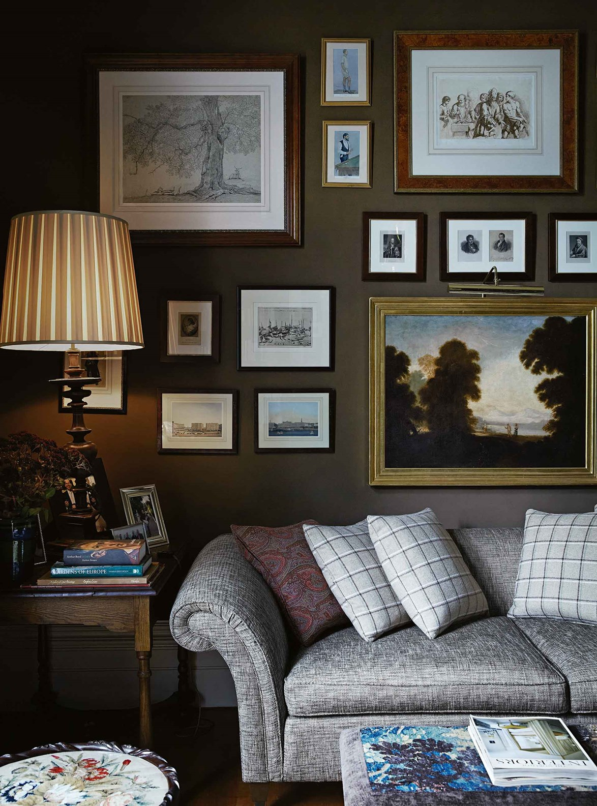 """This subdued living room in a [Victorian weatherboard cottage](https://www.homestolove.com.au/victorian-weatherboard-cottage-13492