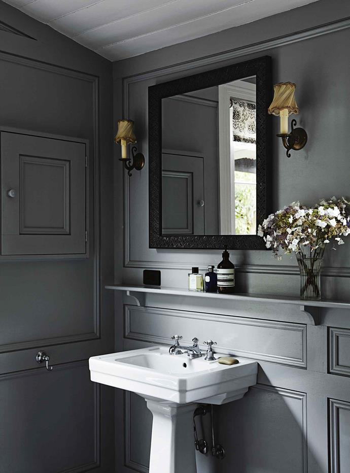 The bathroom features vintage fittings and is painted in Farrow & Ball's Lamp Room Gray.