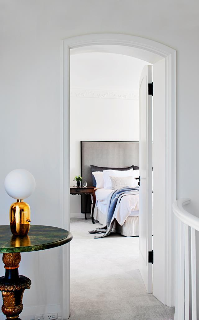"Instead of downsizing, the owners chose to give their much-loved family home a refresh. The [main bedroom](https://www.homestolove.com.au/family-home-reinvented-with-classic-contemporary-style-6793|target=""_blank"") features a custom bedhead by Hecker Guthrie in Andrew Martin 'Hoffman' quilted fabric. From *Belle* August/September 2017."