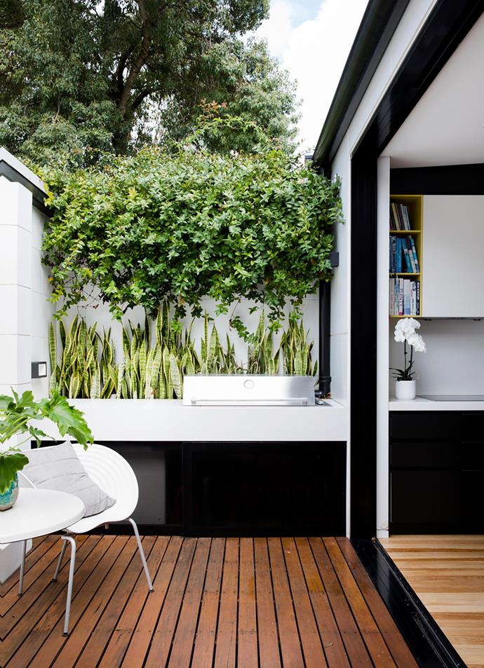 The barbecue area is essentially an extension of the kitchen. Barbecue, BeefEater Barbecues. Vitra 'Tom Vac' chairs by Ron Arad, Space. Blackbutt decking.
