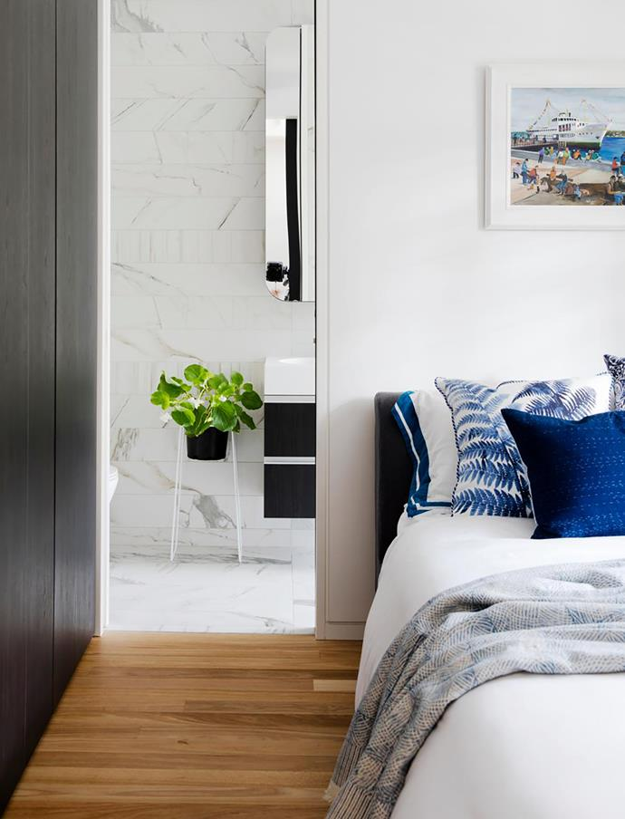 Closing off the original entry hall created room for an ensuite, increasing the property's liveability and value. Midnight Tree Fern and Indigo Tile cotton cushions, Planet. Japanese cushion and block-printed throw, both Chee Soon & Fitzgerald. Artwork by Gulen Inceoglu
