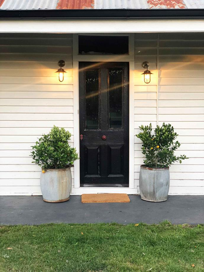 "Welcome to the Cottage at Dunmore Farm. Dwarf lemon trees in galvanised steel dolly tubs from [Scout Home Goods](https://www.scouthouse.com.au/|target=""_blank""