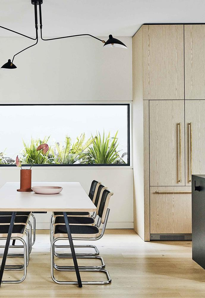 """**Kitchen and dining** Two picture windows allow light in and views out to the planter boxes beyond. Walls are painted [Dulux](https://www.dulux.com.au/