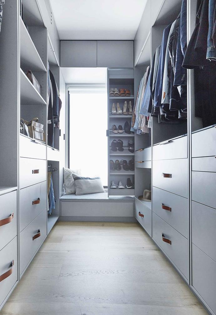 **Walk-in robe** Lots of drawers and practical shoe storage next to a built-in seat are the definition of luxury.