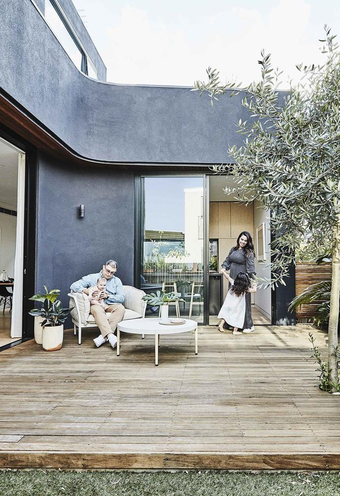 """**Exterior** The back of the home opens to a blackbutt deck that follows the curved shape of the rendered wall [Dulux](https://www.dulux.com.au/