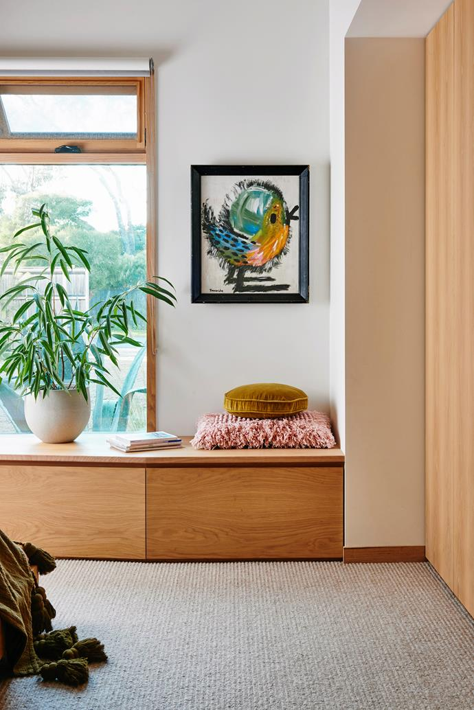 A built-in window seat provides extra storage as well as another place to sit  or stretch out.