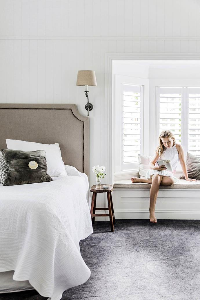 "This [elegant headboard](https://www.homestolove.com.au/gallery-kylie-and-brett-create-their-perfect-queenslander-1431|target=""_blank"") and window seat cushion were made in Hong Kong. For similar headboard, try Heatherly Design Bedheads."