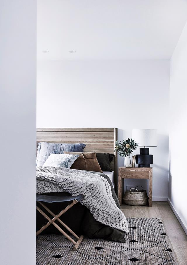 "This wooden headboard perfectly ties in with the [earthy and modern](https://www.homestolove.com.au/my-ideal-house-tour-7089|target=""_blank"") aesthetic of this bedroom."