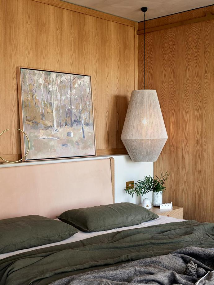 Above the 'Finley' bed from Jardan sits a vase by Anna Varendorff alongside an artwork by David Moore. Bed linen from Bedouin Societe. 'Dream Weaver' pendant light from Pop and Scott.