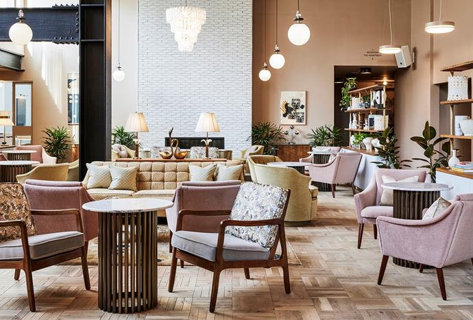 The lobby is located deep inside the hotel which creates an intimate atmosphere. Open shelving and towering columns form cosy nooks for visitors and locals alike to curl up in armchairs and order from the restaurant.