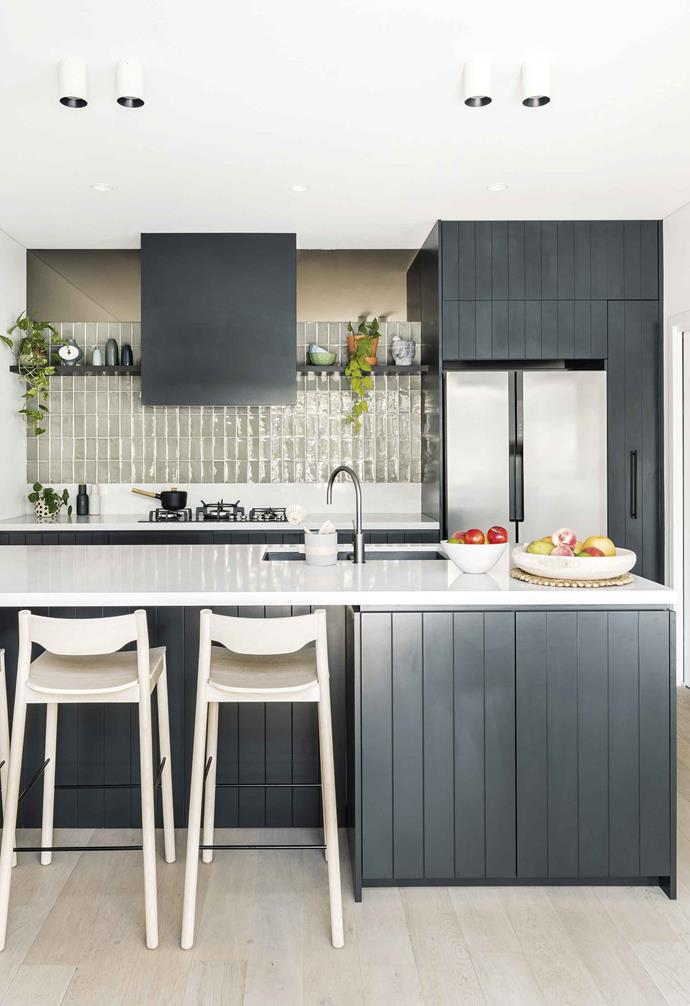 "**Kitchen** ""I did not want another fully white kitchen,"" laughs Lauren. Kimberley designed a warm space with an olive-green tiled splashback, smoked-bronze mirrored panelling, V-groove cabinetry in [Dulux](https://www.dulux.com.au/