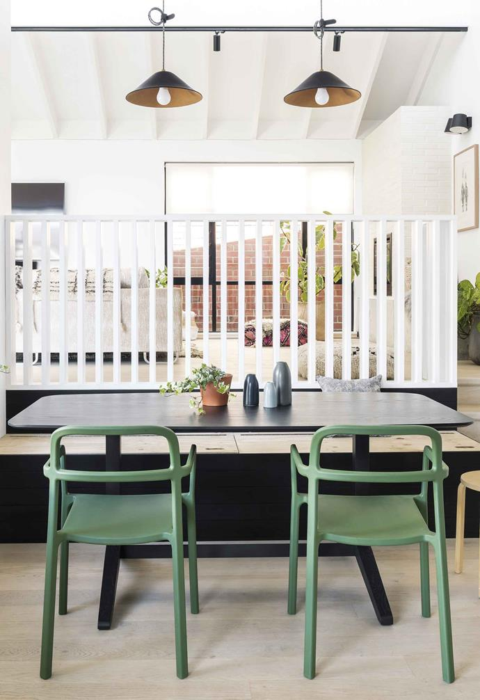 "**Dining room** Inspired by mid-century design the family dining area is light and bright, and created from affordable child-friendly furniture, including a built-in bench seat, green chairs and stool from [IKEA](https://www.ikea.com/au/en/|target=""_blank""