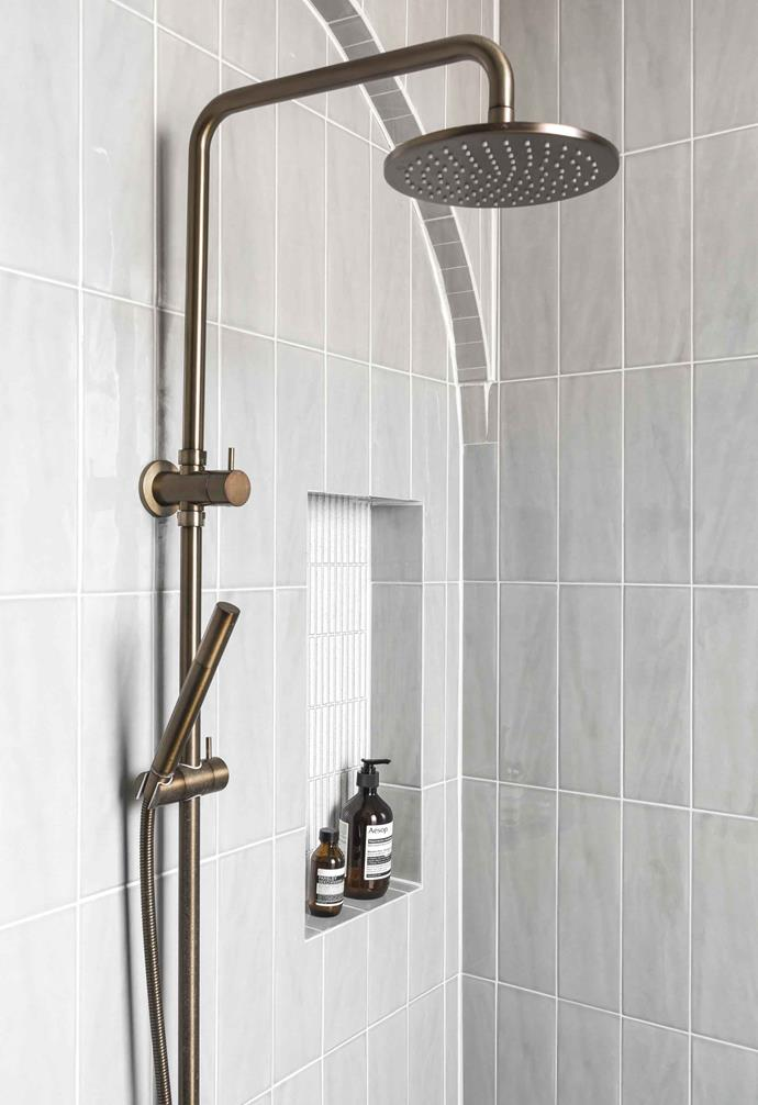 **Shower** Smaller and narrower subway tiles in white are laid vertically in the inset nook, contrasting beautifully against the larger grey subway tiles.