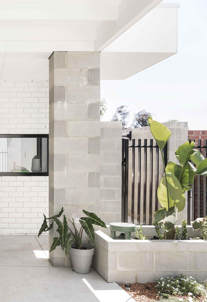 **Outdoor** Leafy plants add a vibrant splash of colour against the neutral bricks and tiles.
