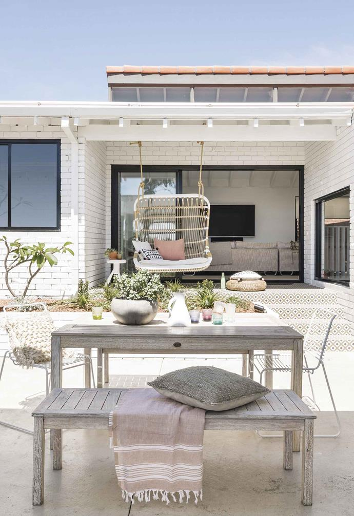 "**Alfresco area** The floor plan was tweaked so the living room opened to the central outdoor courtyard. [Dulux](https://www.dulux.com.au/|target=""_blank""
