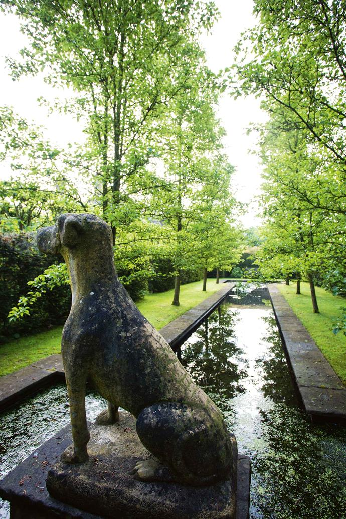 A view of the Dutch canal, which is flanked by ornamental pear trees (Pyrus calleryana 'Chanticleer') and guarded over by a stone sculpture.