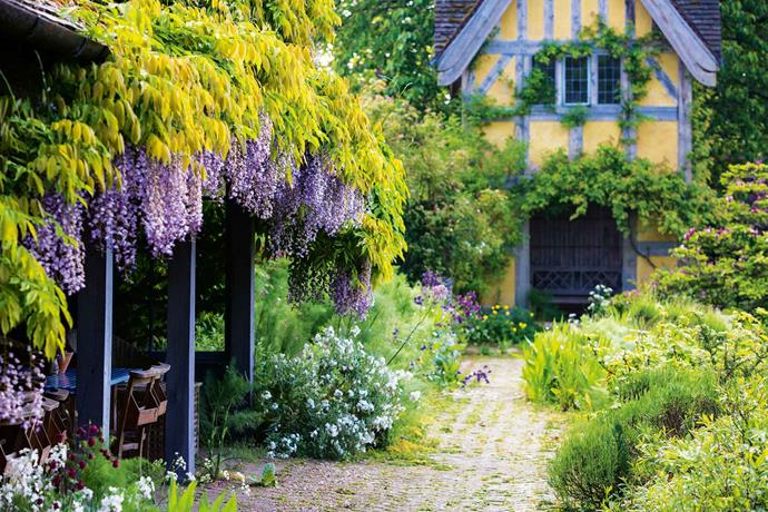 The wisteria-draped loggia looking towards the dovecote.