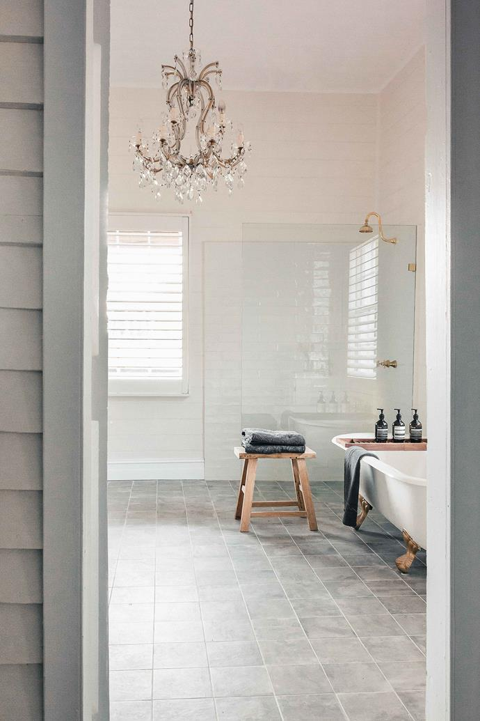 The Cottage's bathroom is both spacious and glamorous. An original Victorian claw-footed tub is complemented by an antique French chandelier bounces light around the room.