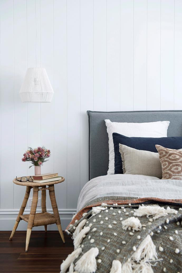 "**It's all about the layers:** Instead of turning up the heater, look to warm up your bedroom by [layering textures and fabrics](https://www.homestolove.com.au/how-to-add-texture-to-your-home-7046|target=""_blank"") that will help trap in heat. Adding a thick wool or faux fur throw to your bed will instantly create an inviting space."