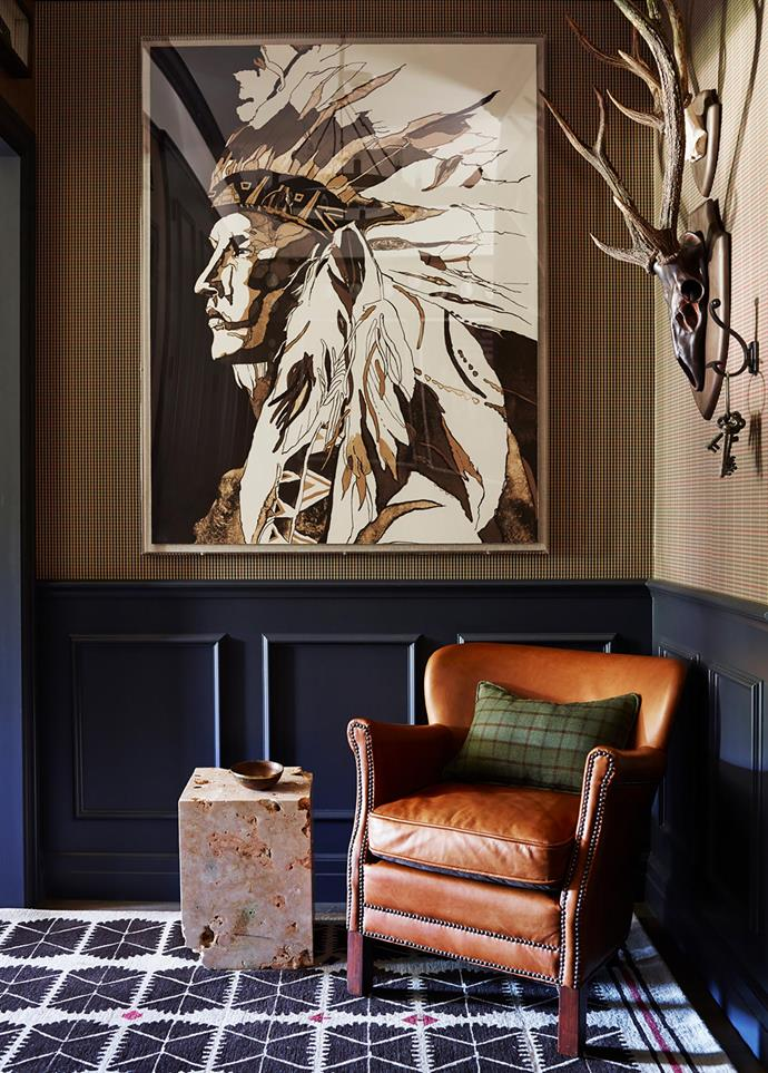 A Natural Curiosities artwork hangs above the RH 'Scholar' stone side table and 'Professor's' leather chair. Cushion made in Ralph Lauren fabric.