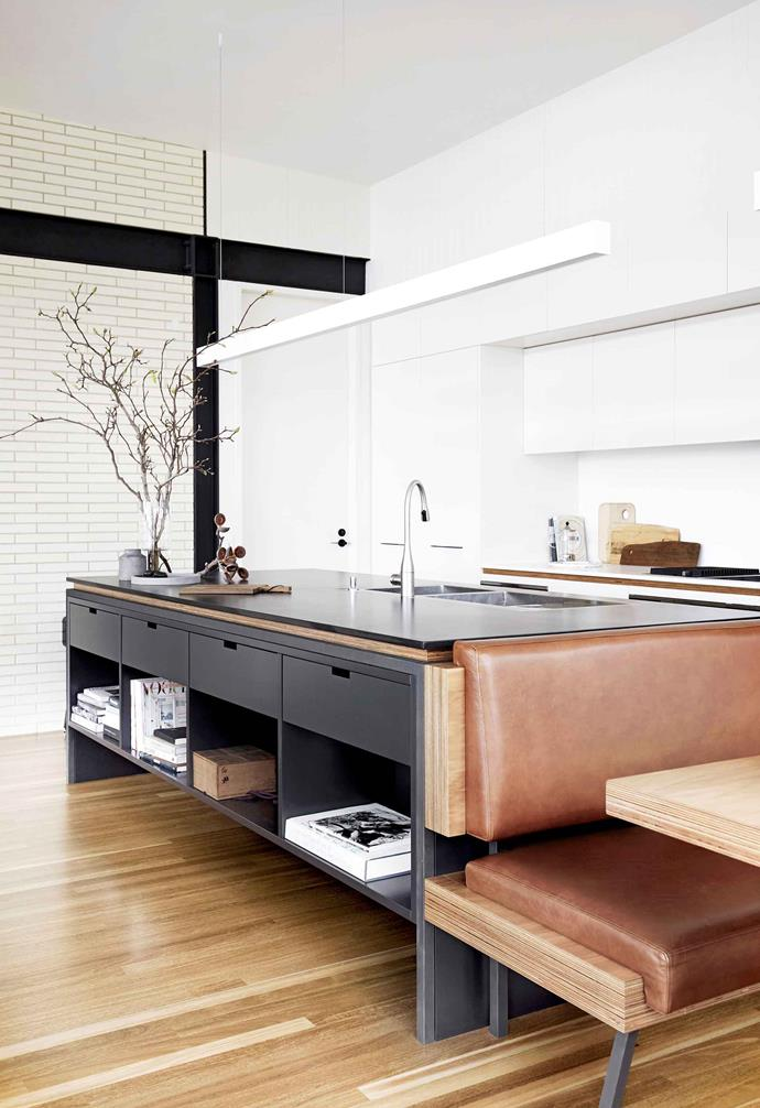 "**Banquette menu** <br><br>Built-in leather booth seating softens the clean lines of this cooking zone, juxtaposed with Stone Italiana Superwhite and Superblack benchtops. The casual dine-in area in this [striking holiday home](https://www.homestolove.com.au/contemporary-mid-century-holiday-home-19459|target=""_blank"") also nods to [mid-century design](https://www.homestolove.com.au/mid-century-modern-homes-20366