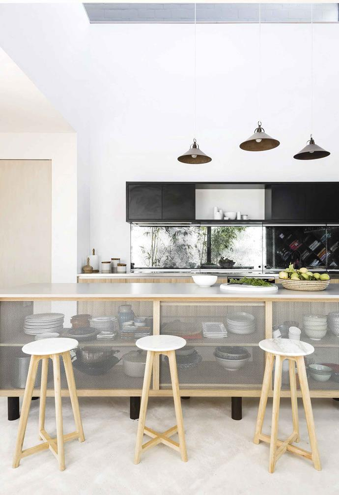 "**Open and shut**<br><br>The waterfall island bench is the main drawcard of Anna and Paul's kitchen in their [split-level home in Fremantle](https://www.homestolove.com.au/wabi-sabi-meets-warehouse-style-living-in-this-perth-home-18946|target=""_blank""). Inspired by a Belgian kitchen, the mesh-fronted [island bench](https://www.homestolove.com.au/kitchen-inspiration-13-of-the-best-island-benches-17943