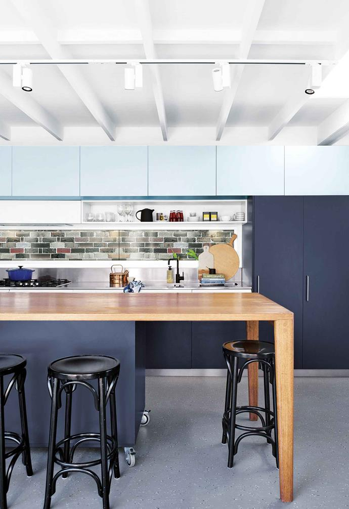 "**Jigsaw puzzle**<br><br>Industrial style doesn't mean no to colour, and this [practical family home](https://www.homestolove.com.au/step-inside-this-colourful-and-practical-family-home-17570|target=""_blank"") proves it. The architect owners of this kitchen had Styline Kitchens craft overhead Laminex cupboards in Fresh Spring and the other joinery in Charcoal, which is broken up by a sliding window splashback showcasing the neighbouring brick wall. The blackbutt bench was designed by homeowner Mark and made by Peter Owens of Babylon Effects.<br><br>"